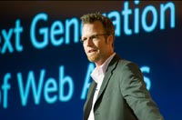 "Jeffrey Veen in s suit with a presentation slide in the background and the words ""Generation Web Apps"""